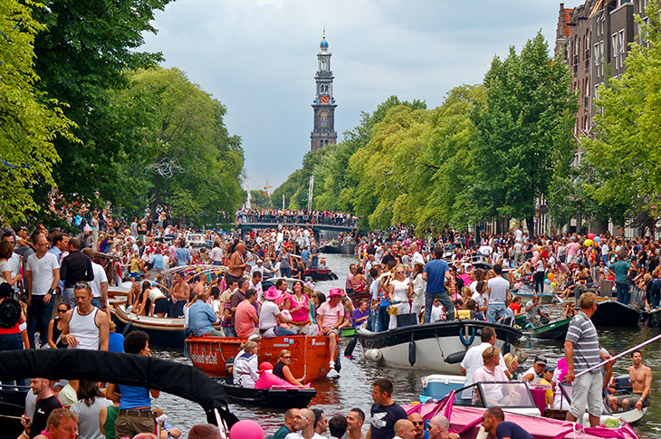 Crowd in one of Amsterdam's canals.